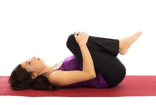 Knees to chest to relieve inflammation