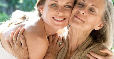 Mature woman embracing her mother