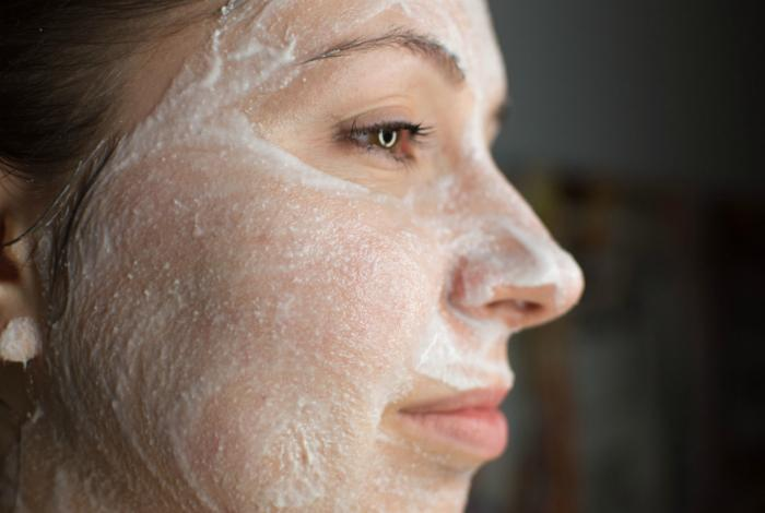 Woman using aspirin on her face